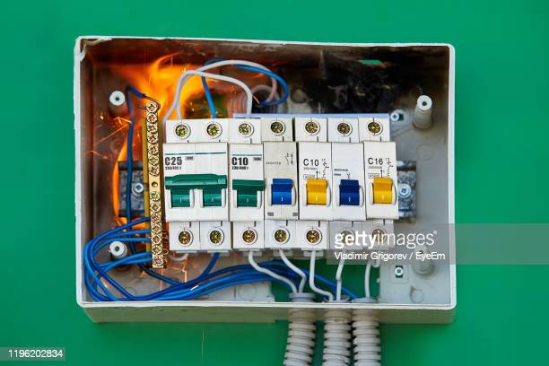 fire in fuse box on wall - electrical panel box stock pictures, royalty-free photos & images