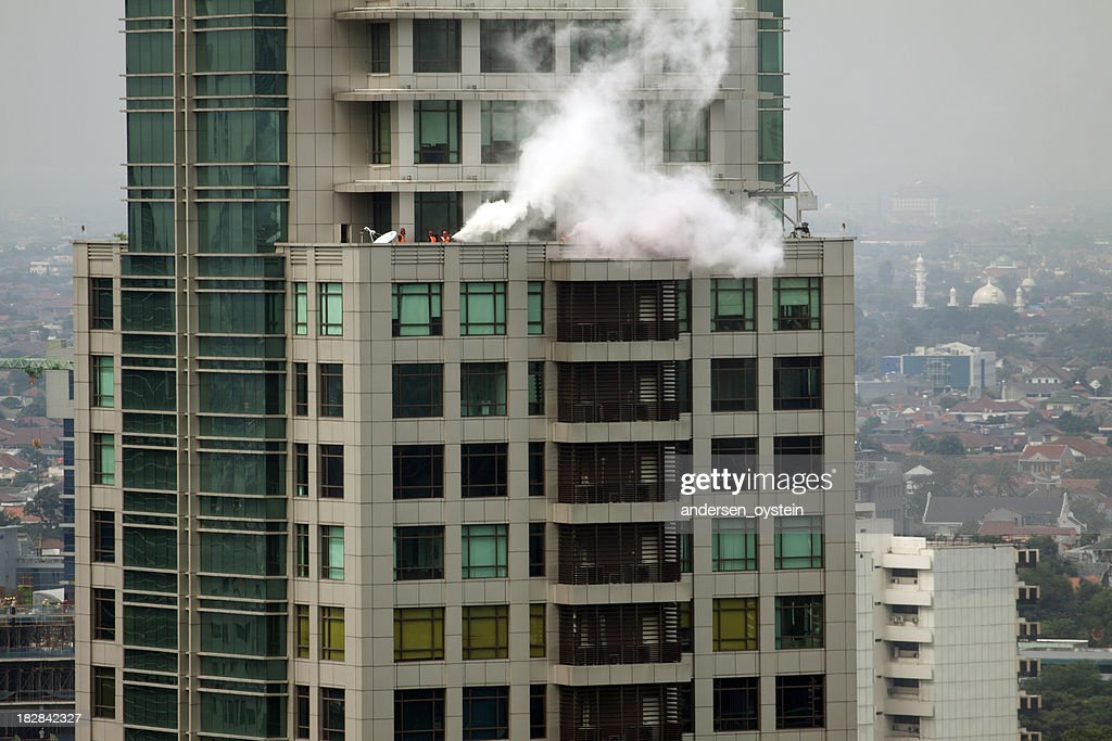 Fire in high rise office building. : Stock Photo