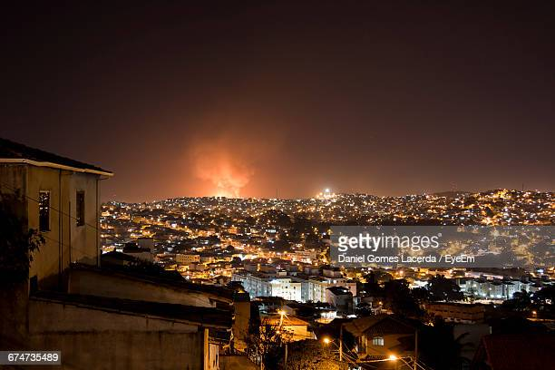 Fire In Illuminated City At Night