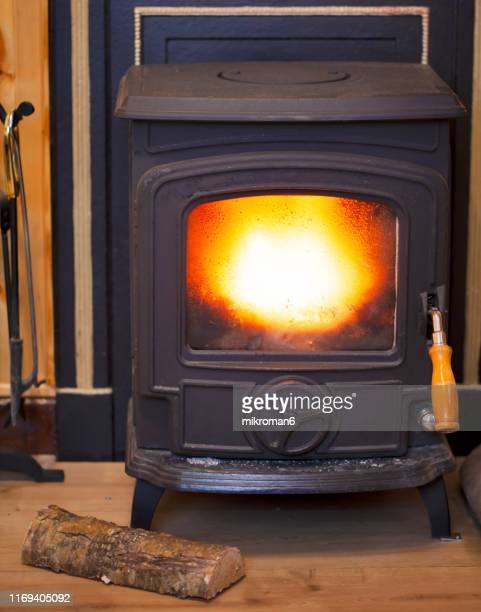 fire in stove - firewood stock pictures, royalty-free photos & images