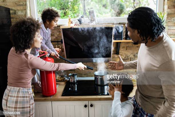 fire in the house! - fire extinguisher stock pictures, royalty-free photos & images