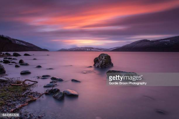 fire in the sky. - loch ness stock photos and pictures