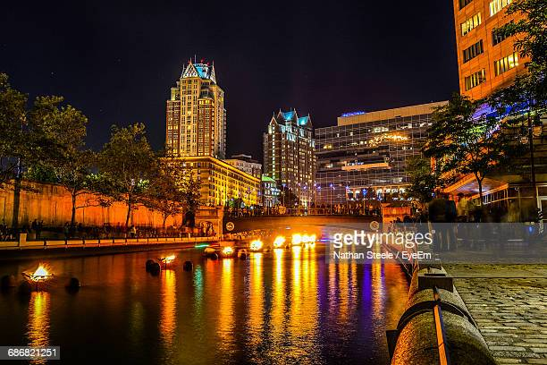 fire in water during event against buildings at night - rhode island stock pictures, royalty-free photos & images
