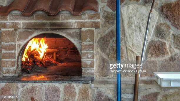 fire in wood burning stove - pizza oven stock photos and pictures