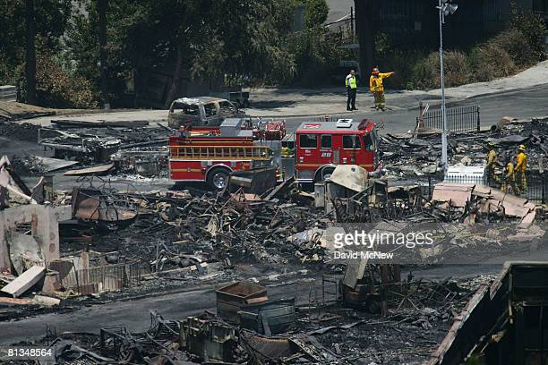 Fire investigators search for clues in the ruins of the Universal Studios backlot on June 2 2008 in Universal City California The fire destroyed the...