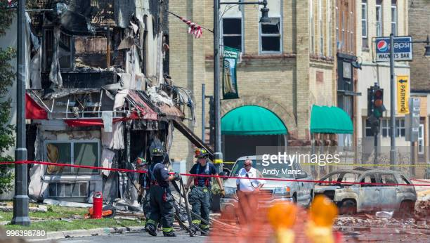 Fire investigators work the scene after a gas leak explosion destroyed at least four buildings on July 11 2018 in Sun Prairie Wisconsin One...