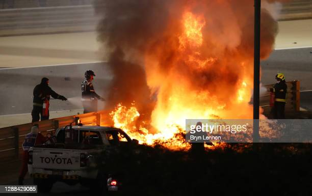 Fire is pictured following the crash of Romain Grosjean of France and Haas F1 during the F1 Grand Prix of Bahrain at Bahrain International Circuit on...