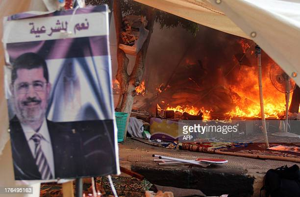 Fire is seen burning in Cairo's al-Nahda square as Egyptian police dispersed supporters of Egypt's ousted president Mohamed Morsi in two huge protest...