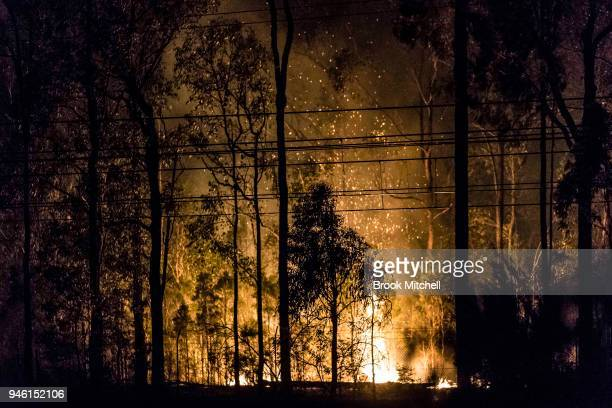 Fire is seen burning inside the Holsworthy Army Base on April 14 2018 in Sydney Australia More than 140 firefighters battled the blaze which started...