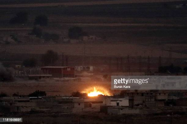 Fire is seen in the Syrian town of Ras alAin on October 17 2019 as seen from Ceylanpinar Turkey The military action is part of a campaign to extend...