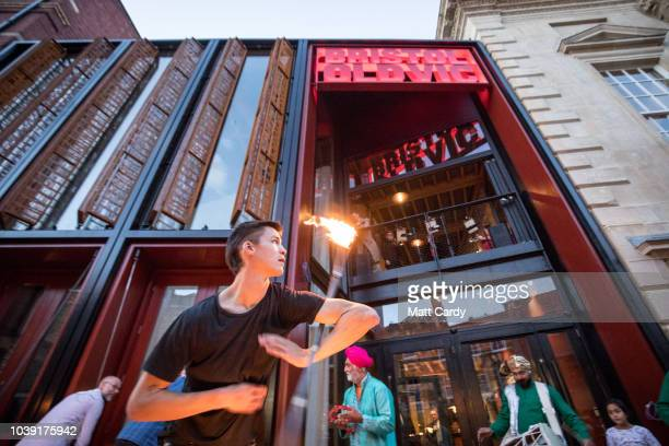 Fire juggler entertains people gathered outside the Bristol Old Vic at the opening of the two-year multi-million pound redevelopment of the oldest...