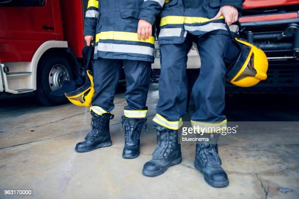 fire man boots and firefighter's helmet - phosphorescence stock pictures, royalty-free photos & images