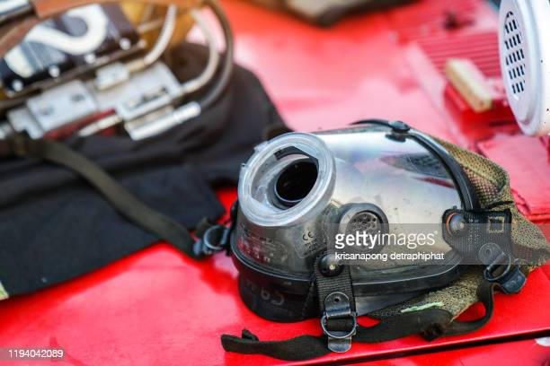 fire mask, a fire protection suit wearing firefighter helmet with breathing device - lieutenant stock pictures, royalty-free photos & images