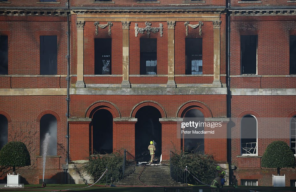 Fire officers continue to douse burning timbers at Clandon Park House on April 30, 2015 near Guildford, England. Salvage operations have begun to rescue antiques from the remains of the 18th century stately home after a fire gutted large parts of the building.
