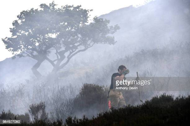 Fire officers continue to fight a large wildfire on the moors above Stalybridge Greater Manchester on June 27 2018 in Stalybridge England...