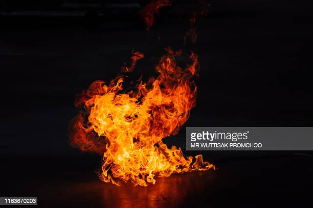 fire on a black background. - exploding stock pictures, royalty-free photos & images