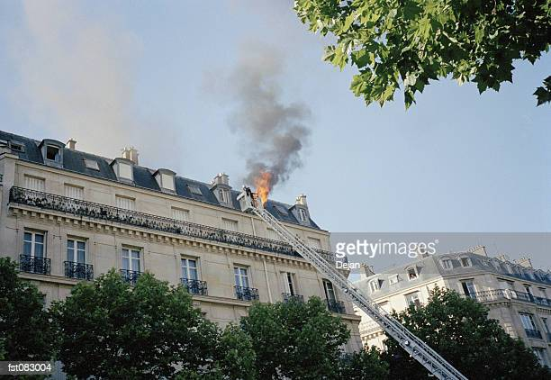 A fire on a rooftop, Paris, France