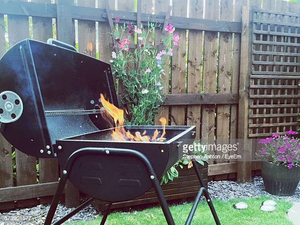 Fire On Barbecue Grill In Yard