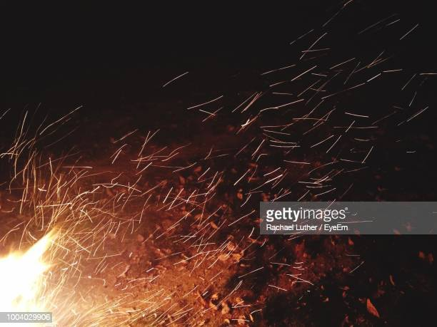 fire on field at night - sparks stock pictures, royalty-free photos & images