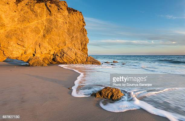 fire on rocks - malibu beach stock pictures, royalty-free photos & images