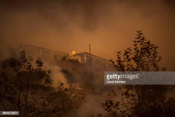 Fire passes between homes at the Thomas Fire on December 16 2017 in Montecito California The National Weather Service has issued red flag warnings of...