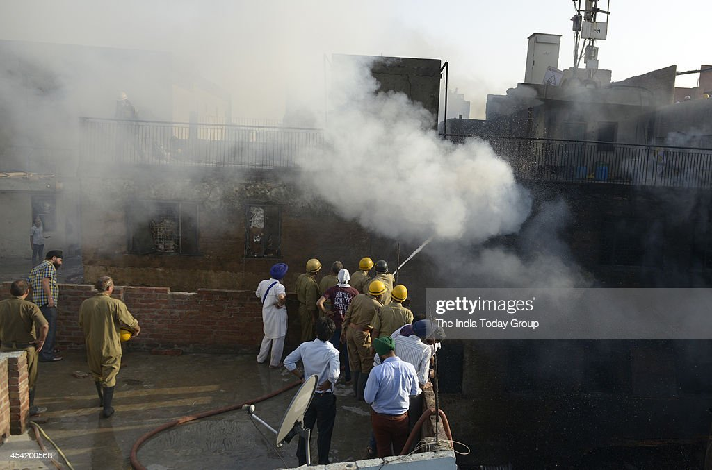 Fire personnel dousing a fire that broke out at Kinari Bazar (Chandni Chowk) in Old Delhi.However there is no casualty.
