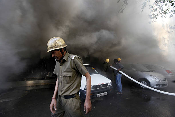 Fire personnel dousing a major fire broke out in a four storey UCO Bank building housing Punjab National Bank at Parliament Street on May 23 2012 in..
