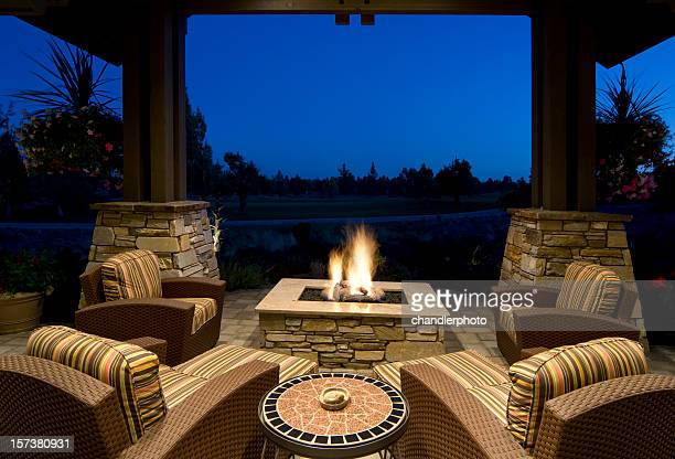 fire pit deck at night - fire pit stock pictures, royalty-free photos & images
