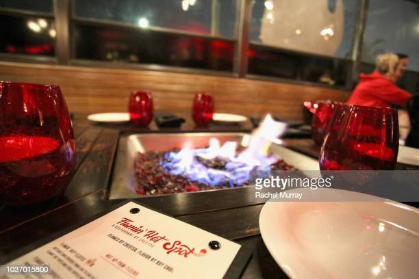 A fire pit on display at The Flamin Hot Spot Cheetos new limitedtime restaurant with a menu inspired by chef Roy Choi at Madera Kitchen on September...