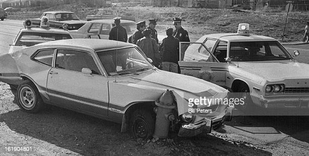 APR 21 1978 Fire Plug Brings An End To HighSpeed Chase Denver Police officers talk to witnesses at West Alamenda Avenue and Utica Street about a...