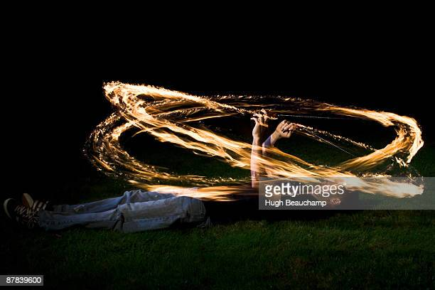 Fire Poi Spinner - Lying down