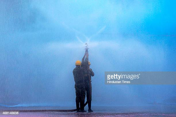 Fire policemen of Delhi Fire Service demonstrating their fire fighting skills during the Raising Day of Delhi Fire Service at Fire Service Management...