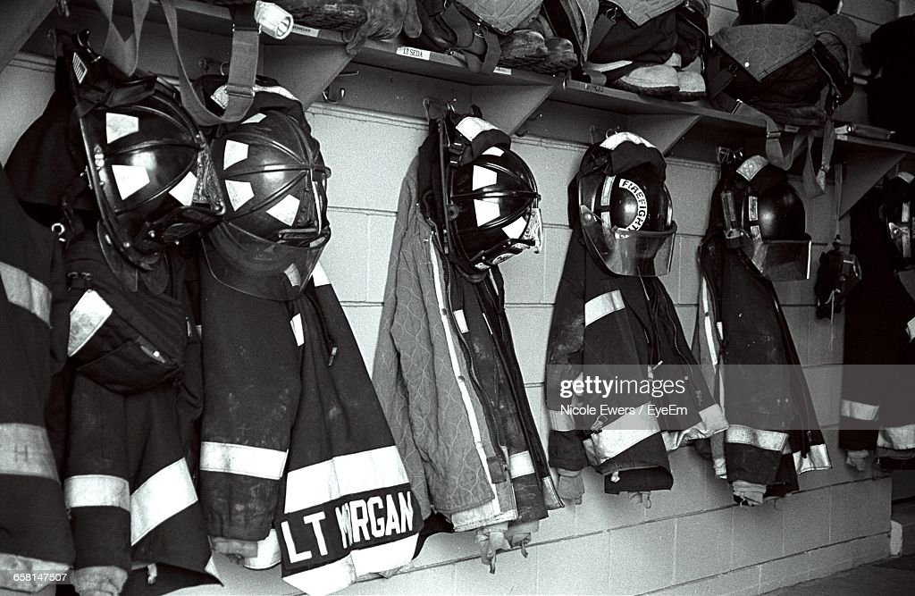 Fire Protection Suits Hanging On Wall : Stock Photo