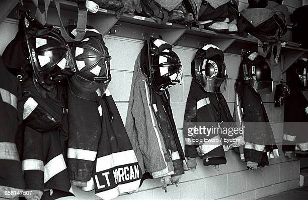fire protection suits hanging on wall - fire protection suit - fotografias e filmes do acervo