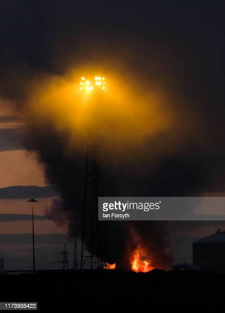 A fire rages as a large pile of processed metal burns sending thick plumes of smoke high into the air on September 11 2019 in Redcar England The fire...