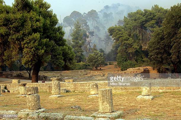 Fire rages close to an archaeological site August 26 2007 in Ancient Olympia Greece More than 50 people have now been confirmed dead in the fires...