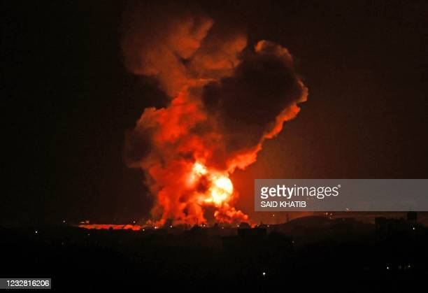 Fire rages following an Israeli air strike overnight on the southern Gaza region of Khan Yunis, controlled by the Hamas movement, early on May 11,...