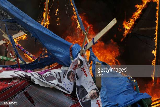 Fire rages in a protest tent as Egyptian security forces moved in to disperse supporters of Egypt's ousted president Mohamed Morsi by force in a huge...