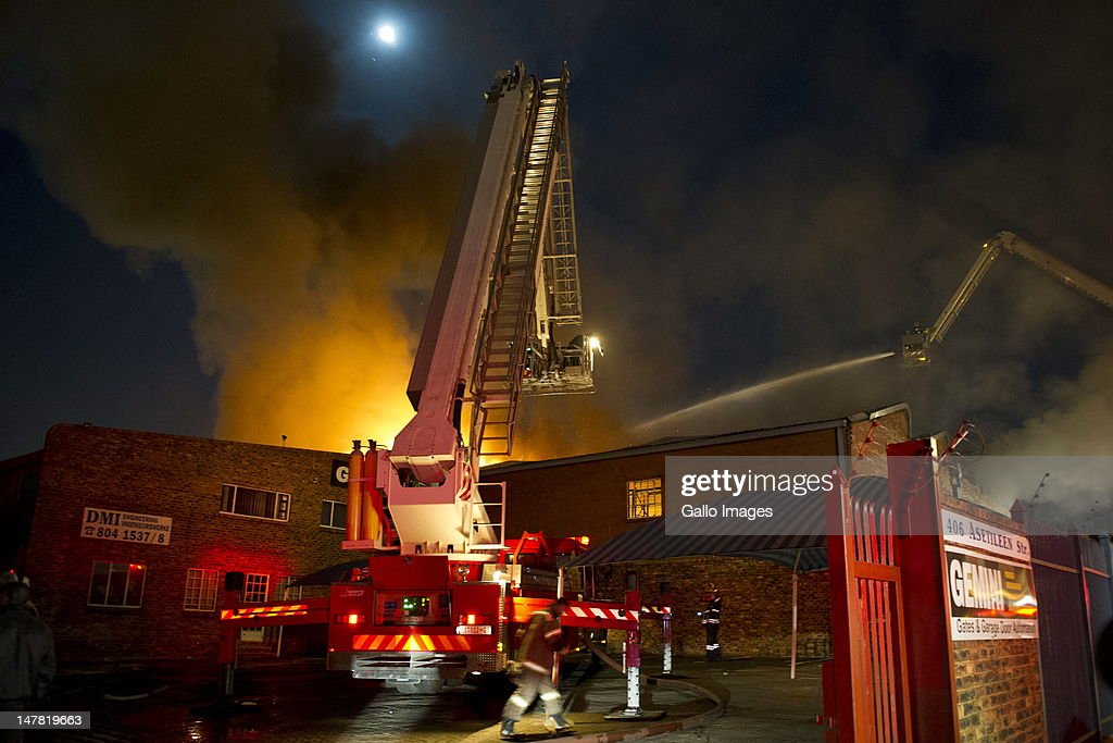 A fire rages in a warehouse belonging to the American embassy in Pretoria, South Africa on July 3, 2012. The warehouse contained furniture and household electric goods. The fire was eventually brought under control when firemen used two hydraulic platforms.