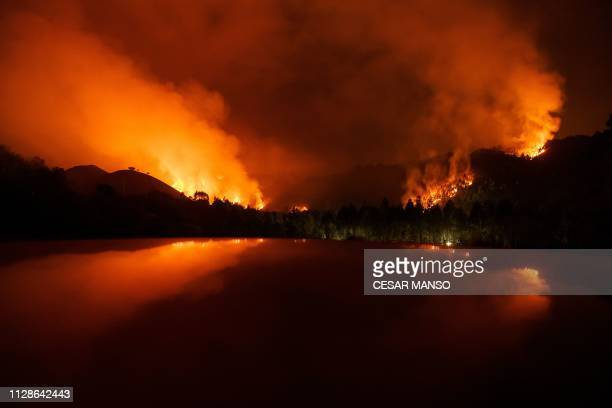 TOPSHOT A fire rages in Posada in the northern Spanish region of Asturias on March 5 2019 Firefighting crews aided by cooler temperatures made...