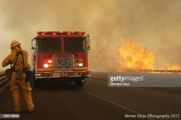 CONTENT] Fire rages on the side of Interstate 5 as Engine 36 makes a stand to prevent the fire from jumping the freeway