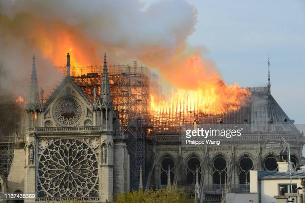 Fire rages through the iconic Notre-Dame Cathedral on April 15, 2019 in Paris, France. A fire broke out on Monday afternoon and quickly spread across...