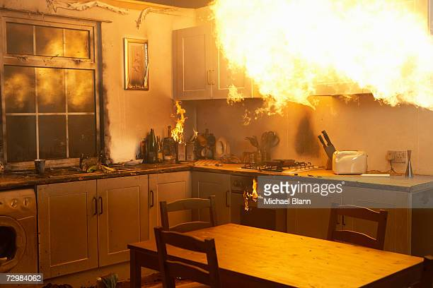fire raging in domestic kitchen at night - fire natural phenomenon stock pictures, royalty-free photos & images