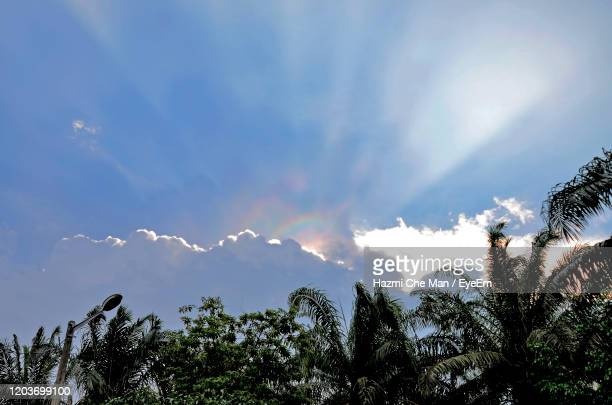 fire rainbow cloud phenomenon where the sun and cloud join then create colourfull sky - light natural phenomenon stock pictures, royalty-free photos & images