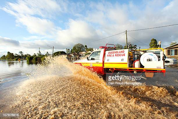 Fire Rescue fourwheeldrive negotiates flooded streets on January 11 2011 in Oakey Australia 10 people so far have been confirmed dead in towns in the...