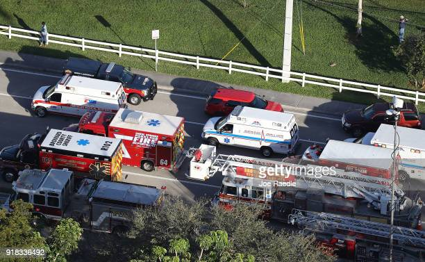 Fire Rescue personnel work the scene at the Marjory Stoneman Douglas High School after a shooting at the school that reportedly killed and injured...