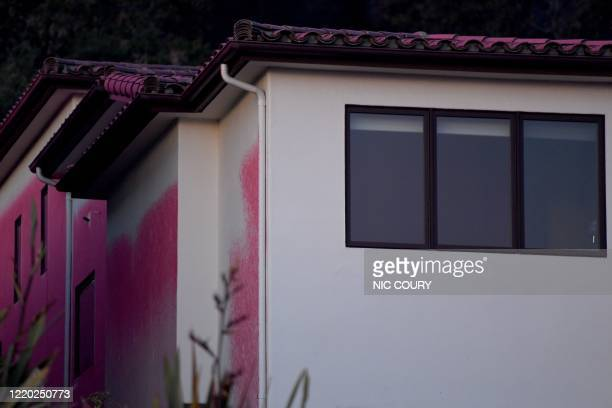 Fire retardant is seen on homes during the Avila Fire in Pismo Beach, San Luis Obispo County, California, June 15, 2020. - The wildfire broke out...