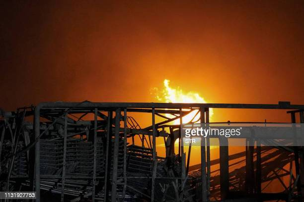 Fire rises following an explosion at a chemical plant in Yancheng in China's eastern Jiangsu province early on March 22 2019 The death toll from a...
