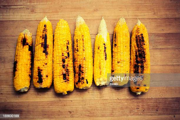 fire roasted corn on the cob - corn on the cob stock pictures, royalty-free photos & images