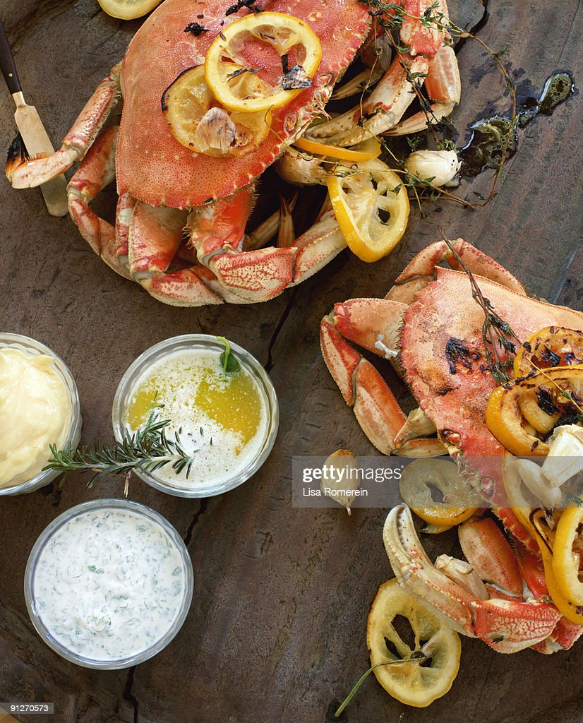 Fire roasted dungeness crabs on wooden table : Stock Photo